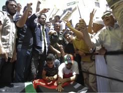 Libyans mourn for rebel commander Abdel-Fattah Younis, who was shot and killed under mysterious circumstances Thursday.