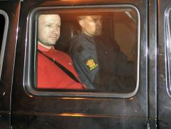 Bomb and terror suspect Anders Behring Breivik  leaves the courthouse in a police car in Oslo on July 25, 2011.