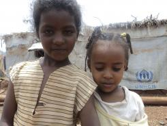 Eritrean girls in the Mai-aini refugee camp in northern Ethiopia, Friday. Among the refugees are large numbers of children who have been sent by their parents to escape open-ended military service.