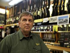Greg Ebert poses for a photo in the Guns Galore store in Killeen, Texas, on Thursday.