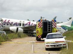 The broken fuselage of a Caribbean Airlines' Boeing 737-800 is seen after it crashed at the end of the runway at Cheddi Jagan International Airport in Timehri, Guyana, on Saturday.