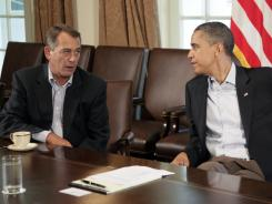 Facing a continuing series of cliffhanger debates:  Both President Obama and House Speaker John Boehner, R-Ohio, shown here in talks over the debt ceiling July 23, appear to have been weakened politically by the standoff.