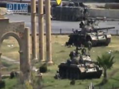 Military armored vehicles are seen in the central city of Hama, Syria.
