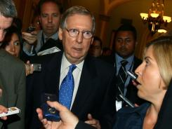 Senate Minority Leader Mitch McConnell talks to reporters Monday. A final Senate sign-off is virtually assured today.