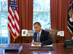 President Obama signs the Budget Control Act of 2011 in the Oval Office on Tuesday.
