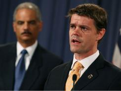 John Morton, right, director of U.S. Immigration and Customs Enforcement, and Attorney General Eric Holder discuss the child pornography case that spans five continents.
