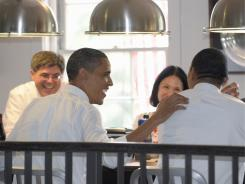 President Obama shares a laugh at lunch Wednesday with aides Jacob Lew, Nancy DeParle, Rob Nabors and Gene Sperling at the Good Stuff Eatery in Washington.