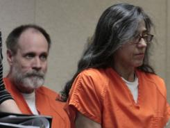 Nancy Garrido takes a seat as her husband, Phillip Garrido looks on last month in court.