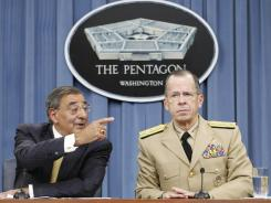 "At the Pentagon:  Leon Panetta, left, with Joint Chiefs Chairman Adm. Mike Mullen, said he would aim for ""common sense "" if faced with automatic defense cuts."