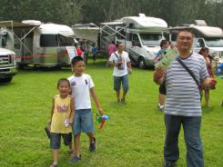 Chinese tourists check out the recreational vehicles on display at the RV rally held in Fangshan, a suburb of Beijing.
