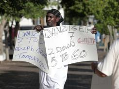Tabari Simpson, of the group 'Community United for Change,' protests outside Federal court  in New Orleans, Monday, June 27 on the opening day of the trial for five current or former New Orleans police officers charged in deadly shootings of unarmed residents on the Danziger bridge in Hurricane Katrina's aftermath.Today, all five officers were convicted of their charges.