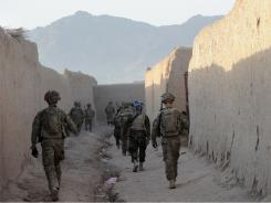 U.S. troops from the 2nd Platoon, Charlie Company under Afghanistan's International Security Assistance Force, and Afghan National Army soldiers conduct a joint security patrol in the center of Kandalay village, in Kandahar province southern Afghanistan on August 4.
