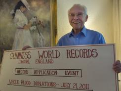 John Sheppard of Fort Myers, Fla., 78, holds a copy of his application for the world record for donating blood.