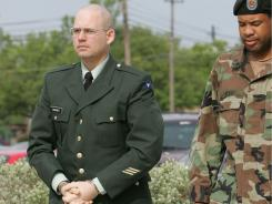 Pvt. Charles A. Graner Jr., left, is escorted into the courthouse during the trial of Spc. Sabrina D. Harman Monday, May 16, 2005, in Fort Hood, Texas. Graner was found guilty of charges involving prisoner abuse at Abu Ghraib prison in Iraq and was sentenced to 10 years and a dishonorable discharge. He was released today, 6 years later.