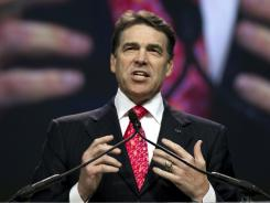 Texas Gov. Rick Perry speaks at The Response, a call to prayer for a nation in Houston.