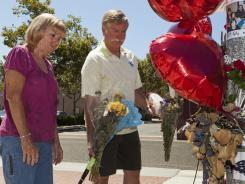 Cathy Thomas and Ron Thomas,  parents of Kelly Thomas, stand next to a memorial for their son on Wednesday in Fullerton, Calif.