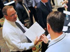 Job fair:  People laid off when the shuttle program ended attend a NASA job fair.