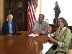 Senate Majority Leader Harry Reid, D-Nev., House Speaker John Boehner, R-Ohio, and House Democratic Leader Nancy Pelosi, D-Calif.,  at a debt meeting in July.