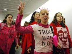 Medea Benjamin, center, co-founder of anti-war group Code Pink, leads a protest in Washington in 2007.