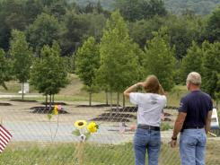 Visitors to the temporary Flight 93 memorial in Shanksville, Pa., look out over a grove of sweet gum trees that were donated by the organizers of the Sept. 11 Memorial in New York.