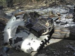 Wreckage of a Chinook helicopter shot down last week is seen at the site of crash in Wardak province in Afghanistan.