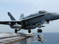 Image provided by the U.S. Navy shows an F/A-18C Hornet launching from the Nimitz-class aircraft carrier USS John C. Stennis. Rescuers saved the crew of a similar jet but haven't found the plane.