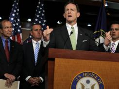 Pennsylvania GOP Sen. Pat Toomey speaks during a news conference on July 26.