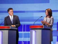 Former Massachusetts governor Mitt Romney and Minnesota Rep. Michele Bachmann participate in Thursday night's GOP debate in Ames, Iowa.