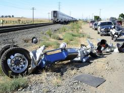 Emergency crews work at the scene of a crash Aug. 1 involving an Amtrak train and a tractor-trailer near Vacaville, Calif. Police said the truck was stopped on the tracks when it was hit.