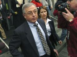 Former judge Mark Ciavarella, center, leaves the federal courthouse in 2009 in Scranton, Pa. He surrendered Thursday after being sentenced to 28 years.