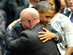 President Obama hugs NASA astronaut Mark Kelly, husband of Rep. Gabrielle Giffords, at the memorial for the Tucson shooting victims in January.