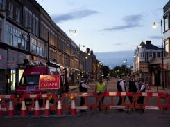 Police block access to a street Thursday in Tottenham, north London.