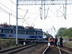 Fire brigade officers check wagons after a train derailed in Poland, Friday.
