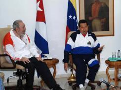 Fidel Castro listens to Venezuelan President Hugo Chavez in Havana in this undated picture.