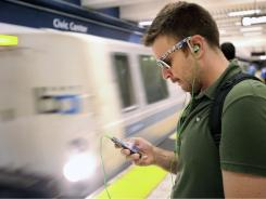 Nick Sabatasso checks his cellphone while waiting for a BART train at San Francisco's Civic Center station on Saturday.