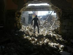 A man inspects the Mar Afram Syriac Orthodox Church after an explosion Monday in Kirkuk as attacks hit Iraq.