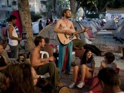 Tel Aviv camp: Israelis play music during a demonstration this month against the costs of living.