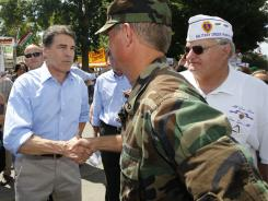 Republican presidential candidate Rick Perry greets veterans and reservists as he visits the Iowa State Fair in Des Moines on Monday.