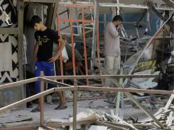 Violence continued in Iraq with the execution killings of seven people pulled from a mosque. Earlier, people inspected bomb damage.