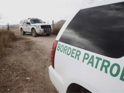 U.S. Border Patrol officers search last December along the border for a suspect in the killing of a U.S. agent.