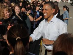 President Obama greets spectators Tuesday in downtown Decorah, Iowa, during a three-day trip through the Midwest.