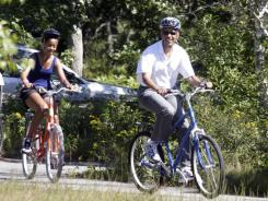 President Obama and daughter Malia bike on Martha's Vineyard last August.