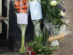 Flowers are placed at the scene where Richard Bowes was killed in the riots on Aug. 12 in Ealing, England.