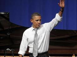 President Obama waves to the crowd after speaking at a fundraiser in Chicago on Aug. 3.