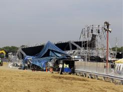 Investigators examine the stage that collapsed on Saturday at the Indiana State Fair.
