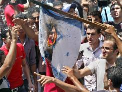 Egyptian protesters burn an Israeli flag during an anti-Israel protest in front of the Israeli embassy in Cairo on Saturday.