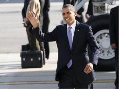 President Obama waves at John F. Kennedy International Airport in August on his way to DNC fundraisers in Manhattan.