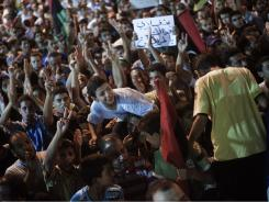 Tens of thousands of Libyans celebrate the arrest of Gadhafi's son Seif al-Islam and the partial fall of Tripoli in the hands of the Libyan rebels on Sunday in Benghazi, Libya.