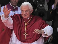 Pope Benedict XVI waves to crowds in Madrid on the Catholic Church's World Youth Day.