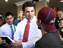 Campaigning:  Texas Gov. Rick Perry in downtown Portsmouth, N.H., on Thursday.